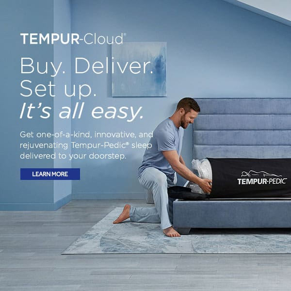 man setting up tempur-cloud mattress in a bag in bedroom